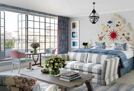 A light and spacious suite with floor to ceiling Crittall windows. There is a king size bed with a statement embroidered headboard
