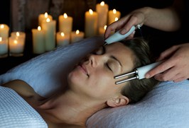 Need a Miracle Facial treatment - a lady undergoing treatment in a candlelit treatment room