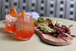 Aperol Spritz cocktails and a sharing platter on the Refuel Terrace