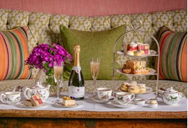 Rathfinny Best of British Afternoon Tea laid out on a table in the Drawing Room at The Soho Hotel with cakes, scones and finger sandwiches